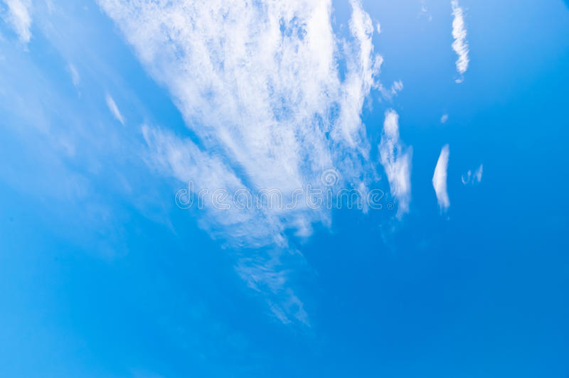 Blue sky and clouds at noon on clean air. Blue sky and clouds at noon on clean air Which saw the details of nature royalty free stock photography