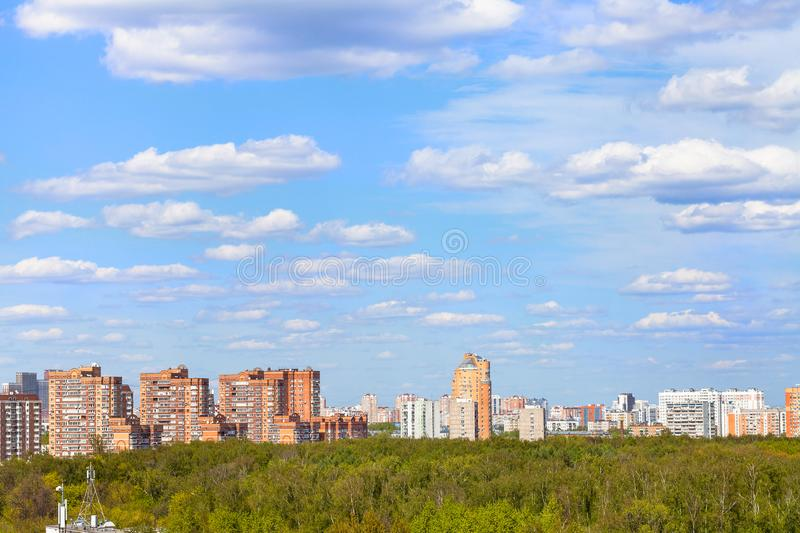 Blue sky with clouds over city park in spring stock photo