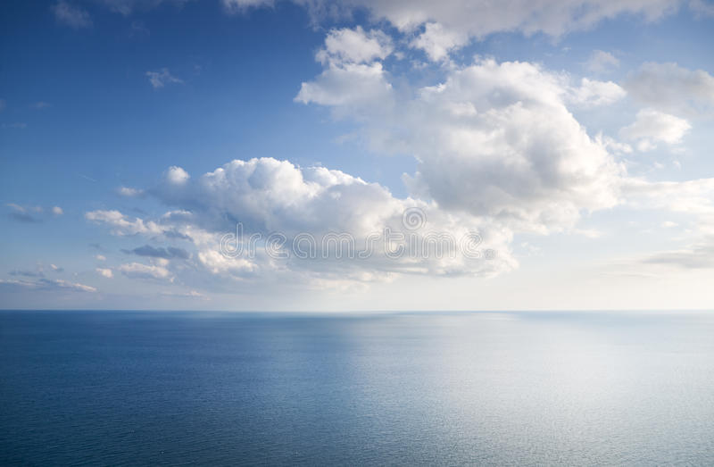 Blue sky with clouds over sea royalty free stock photos