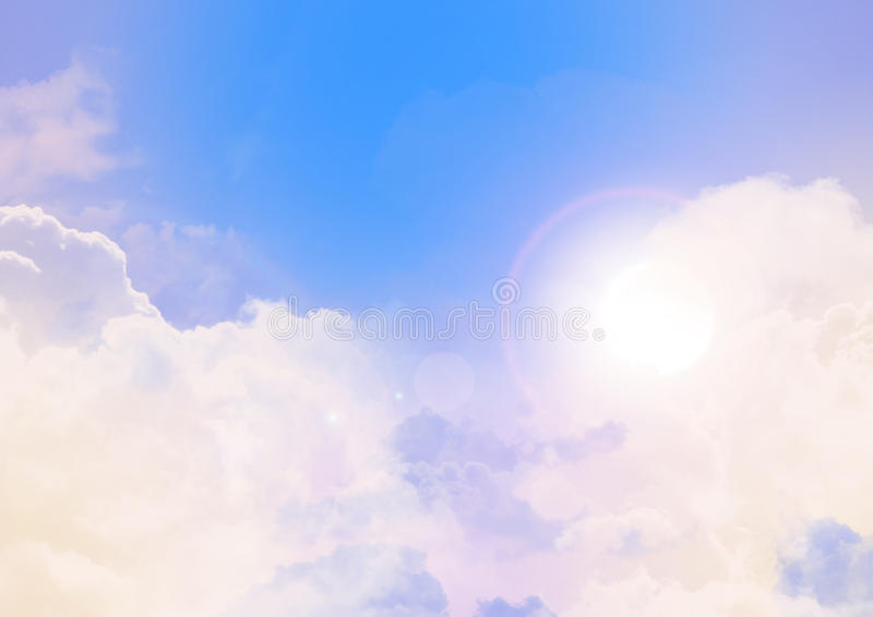 Blue Sky with Clouds. Blue sky with puffy white clouds and the sun royalty free stock image