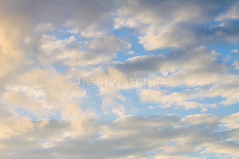 Blue Sky With Clouds Reflecting The Sun royalty free stock photography