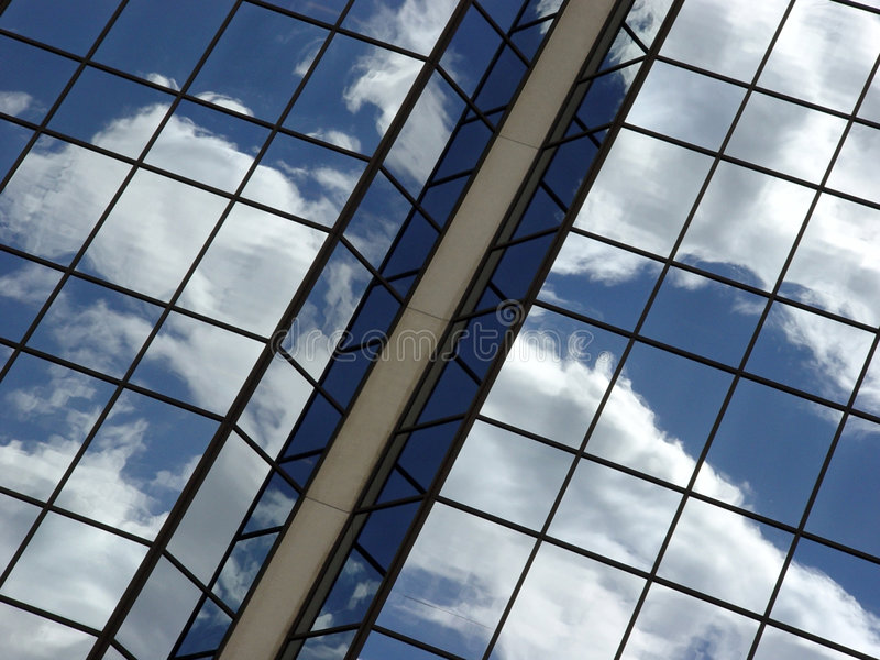 Blue sky and clouds reflection stock photography