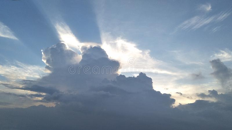 Blue sky with clouds and sun and god rays royalty free stock photos