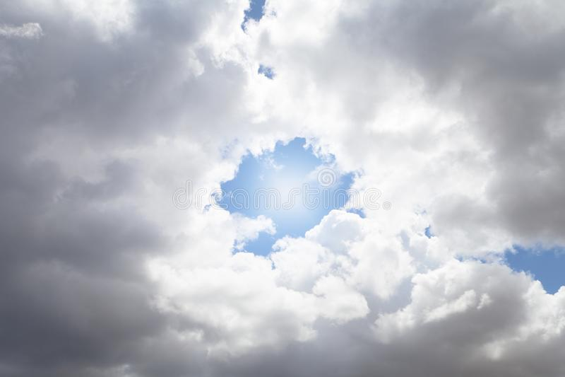 Blue sky, clouds and sun. Image background stock image