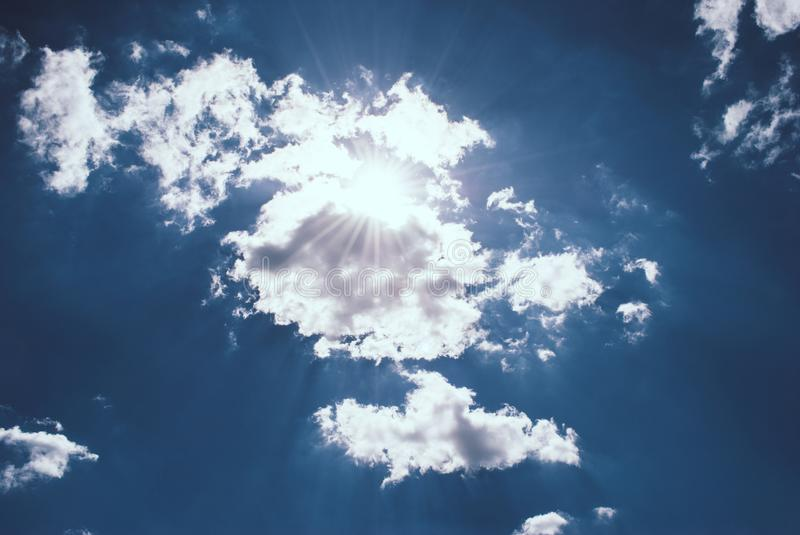 Blue sky with clouds and sun. Perfect background.  stock images