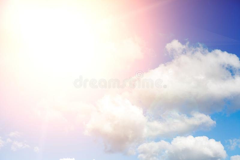 Beautiful blue sky with clouds and sun with rays of light royalty free stock images