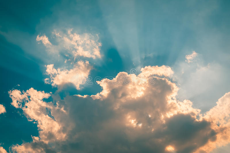 Blue sky with clouds and sun rays. Blue sky with clouds and sun reflection in water with place for your text royalty free stock photography