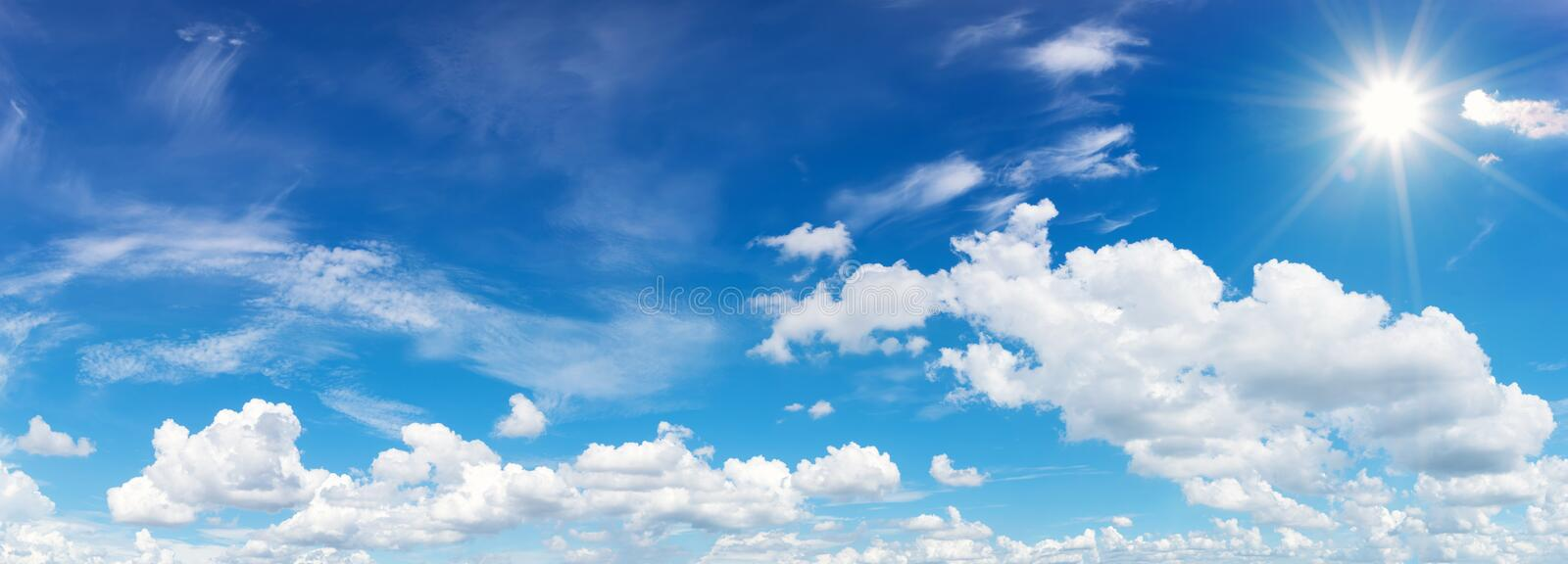 blue sky with clouds and sun reflection.The sun shines bright in royalty free stock images
