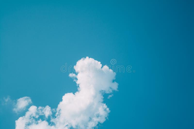 Blue sky clouds sunlight gradient from dark to bright minimalism. Blue sky clouds sunlight gradient from dark to bright day light minimalism royalty free stock image