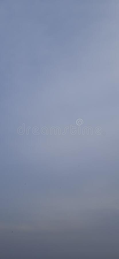 Blue sky and clouds in a sunny day capture for wallpaper design. Useful for many purpose like , party and new year eve ,  kindergarten , children school book stock photos