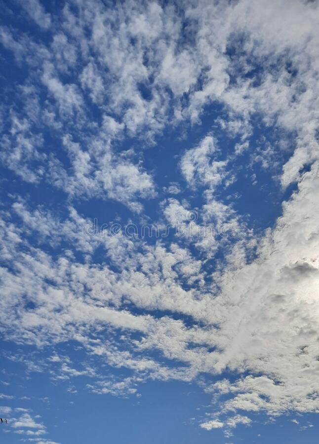 Blue sky and clouds in a sunny day capture for wallpaper design. Useful for many purpose like , party and new year eve ,  kindergarten , children school book stock photography