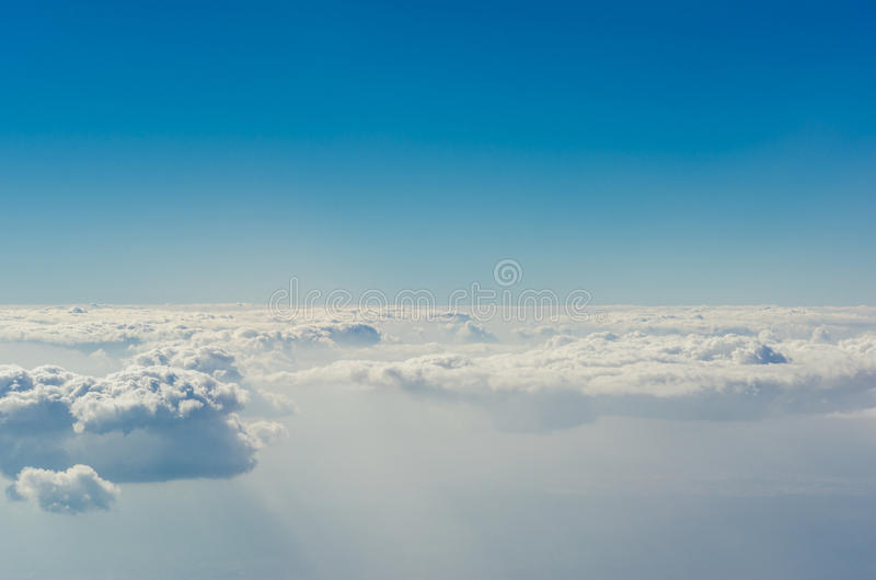 Blue sky with clouds, The upper layers of the atmosphere. Blue sky with clouds, shot from an airplane. The upper layers of the atmosphere royalty free stock photos