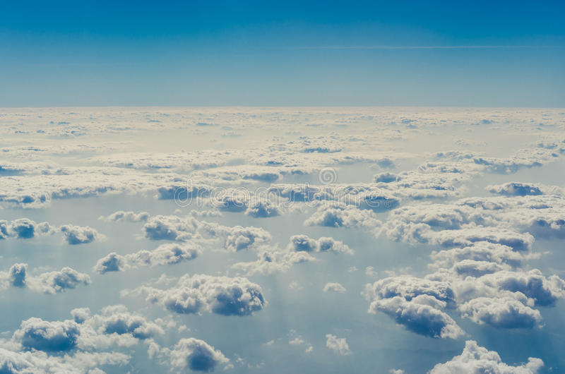 Blue sky with clouds, The upper layers of the atmosphere. Blue sky with clouds, shot from an airplane. The upper layers of the atmosphere royalty free stock photography