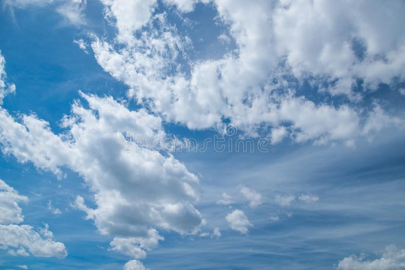 Blue sky with clouds in windy day background. Nature, weather th royalty free stock image