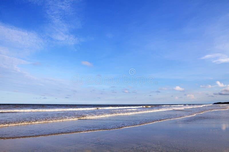 Blue Sky and coast. Blue skies and coast with slight cloud stock photo