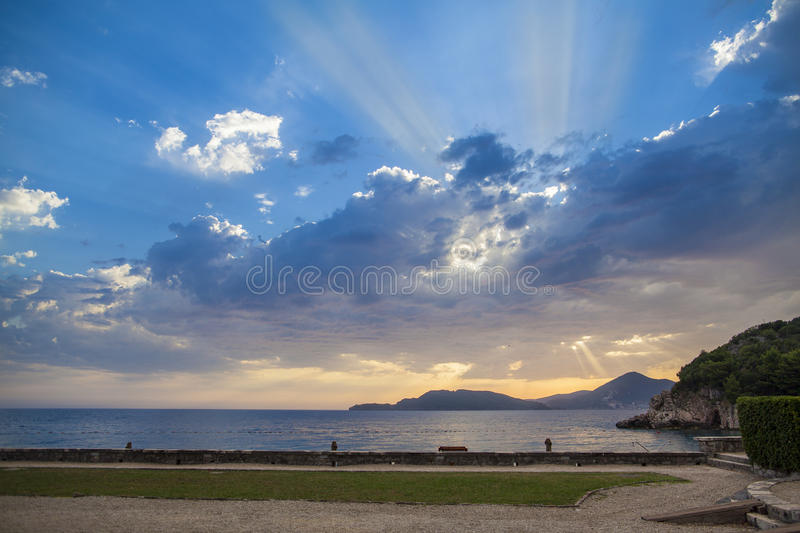 Blue sky and colorful clouds at sunset over Adriatic sea royalty free stock photography