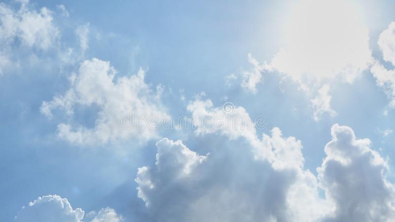 Blue sky with cottony clouds royalty free stock photos