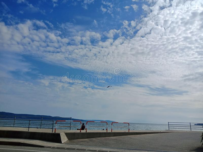Blue sky could over the sea in Sado island , Japan royalty free stock photography