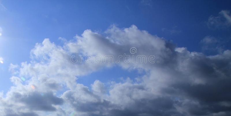 Blue sky and dark cloud stock photo