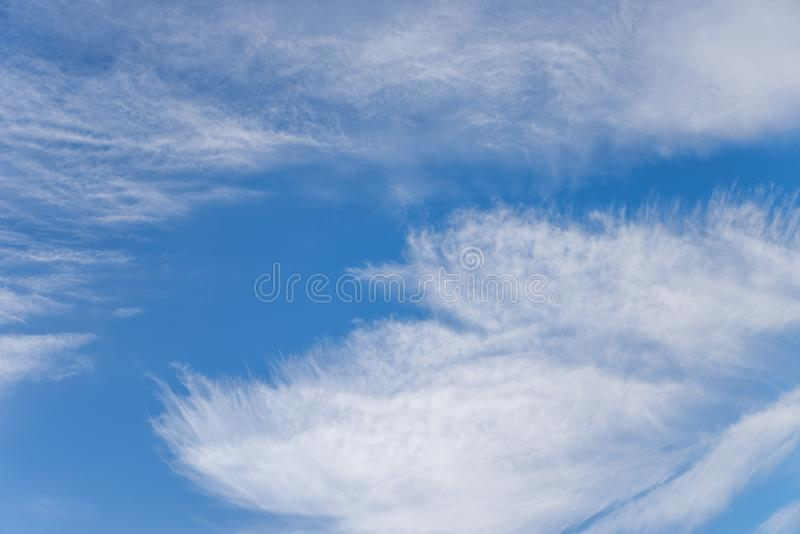 Disheveled fringed clouds during a strong wind with hurricane fo. Blue sky and disheveled fringed clouds during a strong wind with hurricane force royalty free stock images