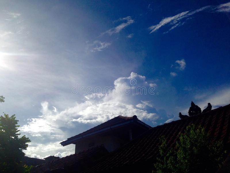 Blue sky. In evening sky with the cloud on the roof royalty free stock photography