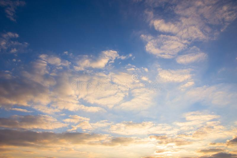 Blue sky and golden clouds at beautiful sunrise royalty free stock images