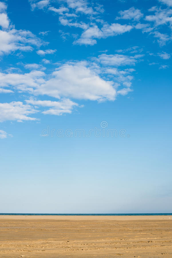 Blue sky and golden sand, Mediterranean royalty free stock images