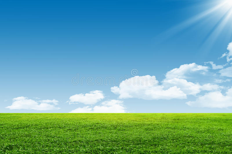 Blue sky and green field stock photography