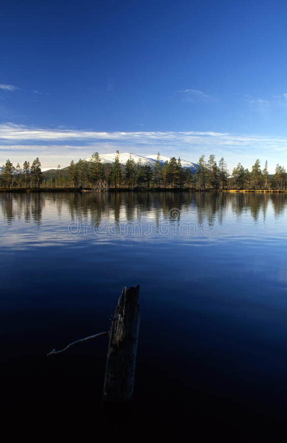 Blue sky and lake in the mountain stock image