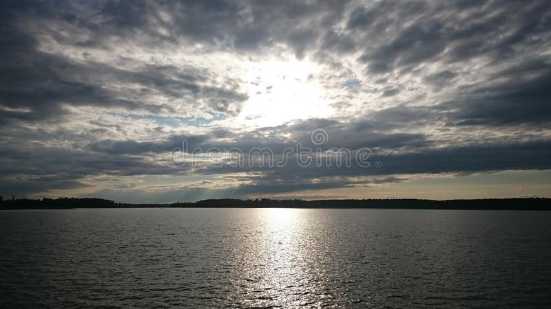 Blue sky and blue lake in summer. White clouds are reflected in the water. The famous lake Seliger. Russia royalty free stock photos