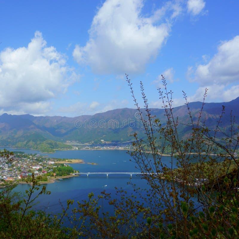 Blue sky and blue lake view from the top of the mountain Tenjo-Yama. Landscape beautiful Lake Kawaguchiko, Japan stock photography
