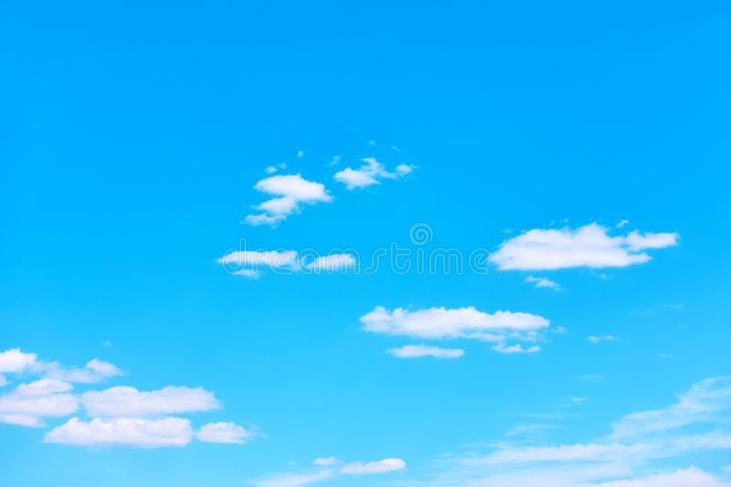 Blue sky with light white clouds royalty free stock photography