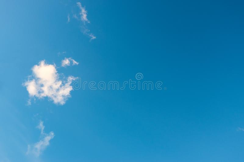 Blue sky and little fluffy clouds in the summer. Amazing cloudy royalty free stock image