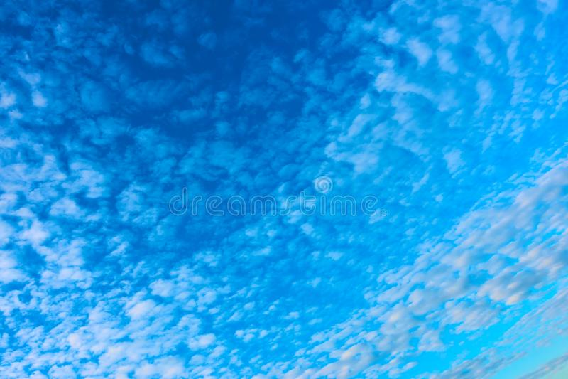 Blue sky with lots of small clouds stock photo