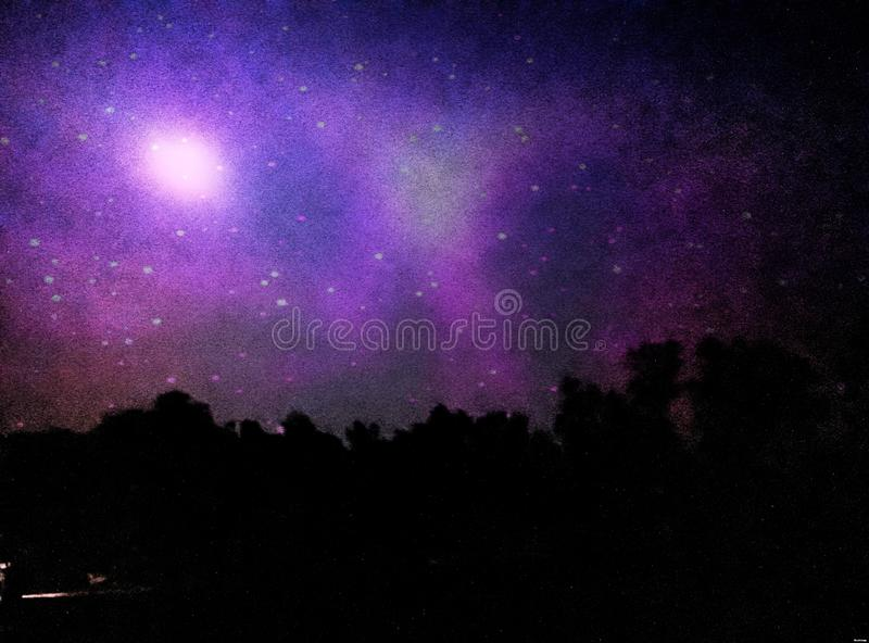 Blue Sky in Low Light. Sky in Low Light. Awesome, colour, combination, different, amazing, trees, dark, bright royalty free stock photos
