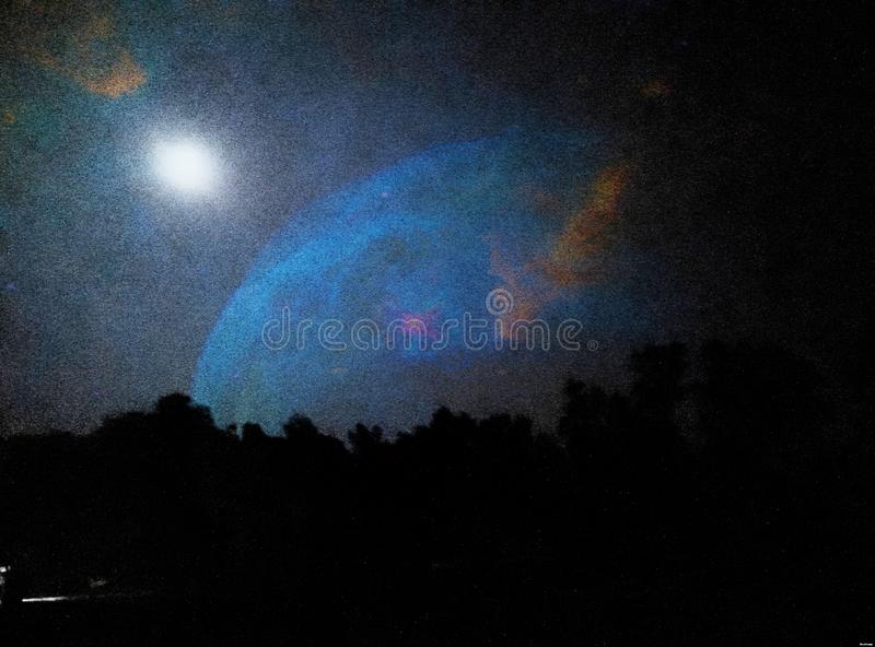 Blue Sky in Low Light. Sky in Low Light. Awesome, colour, combination, different, amazing, trees, dark, bright royalty free stock images