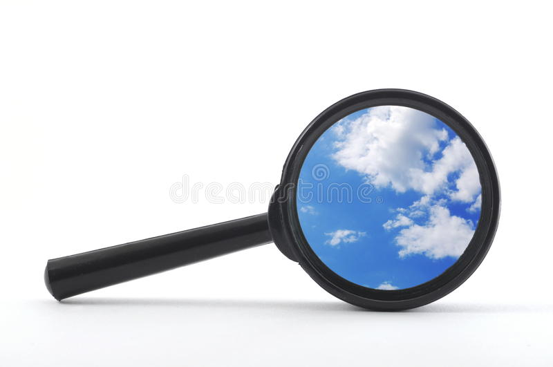 Blue sky and magnifying glass royalty free stock image