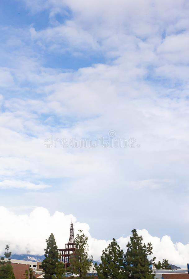 Blue sky with many giant clouds with buildings and trees. After a storm stock images