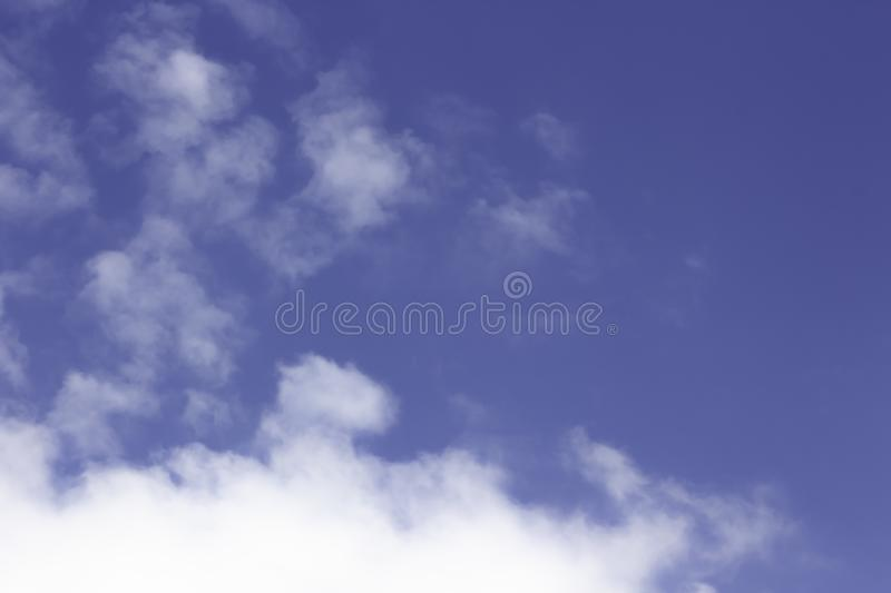 Blue sky with many white clouds stock photography