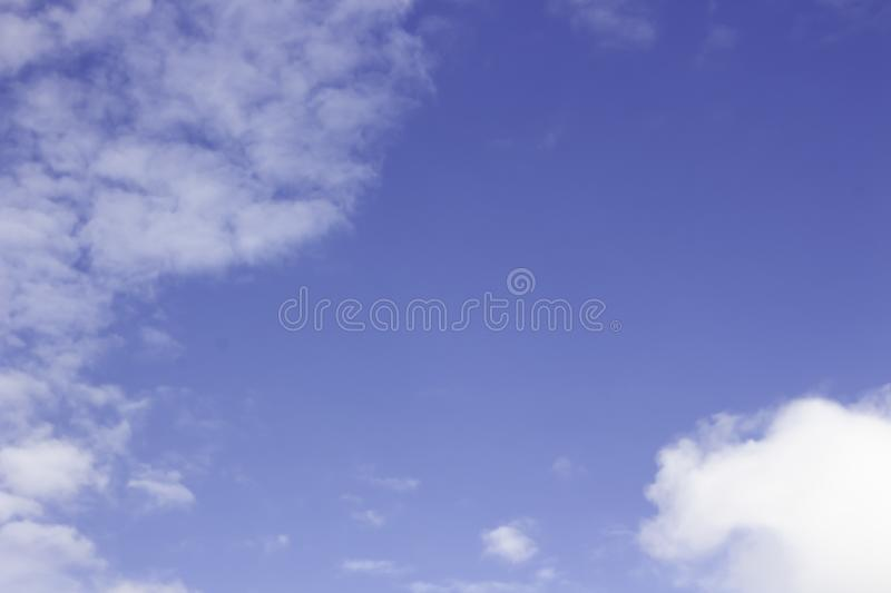 Blue sky with many white clouds stock photos