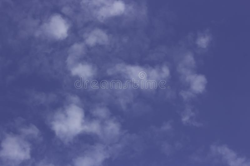 Blue sky with many white clouds stock image