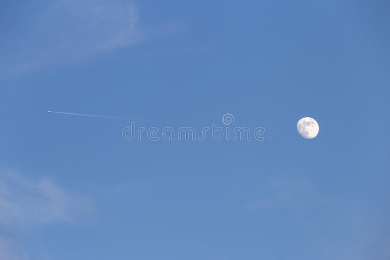 Blue sky with a moon on a day light royalty free stock photo
