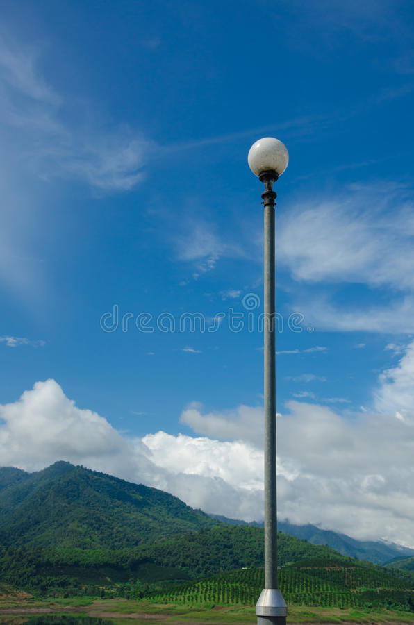 Blue sky and mountain background with lamp pole royalty free stock photos