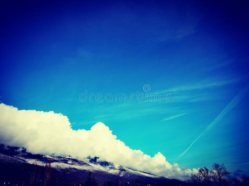 Blue sky and mountains background stock photo