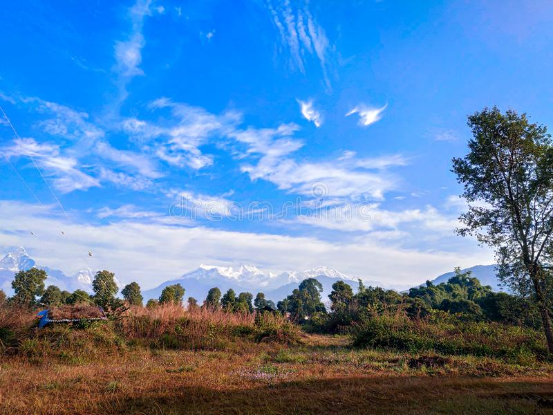 Blue sky mountains forest and grassland all in one picture. Beautiful landscape Pokhara Nepal stock photos
