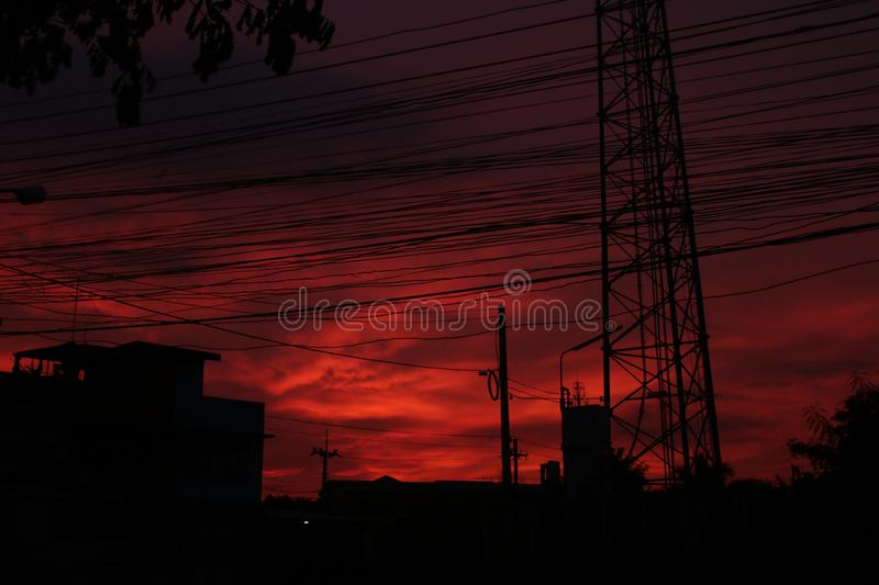 Red sky at night and high voltage pole and wire . Red sky at night and high voltage pole and wire royalty free stock image