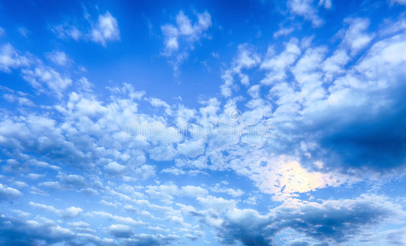 Blue sky at night with moon and clouds.  royalty free stock photography