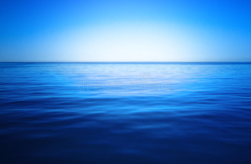 Blue sky and ocean stock images