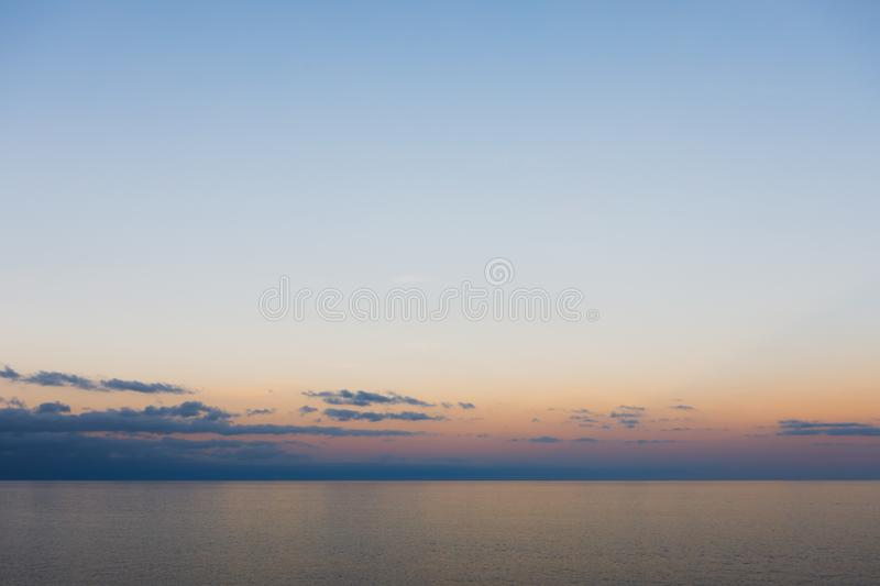 Blue sky and ocean at sunset, minimalism background stock image