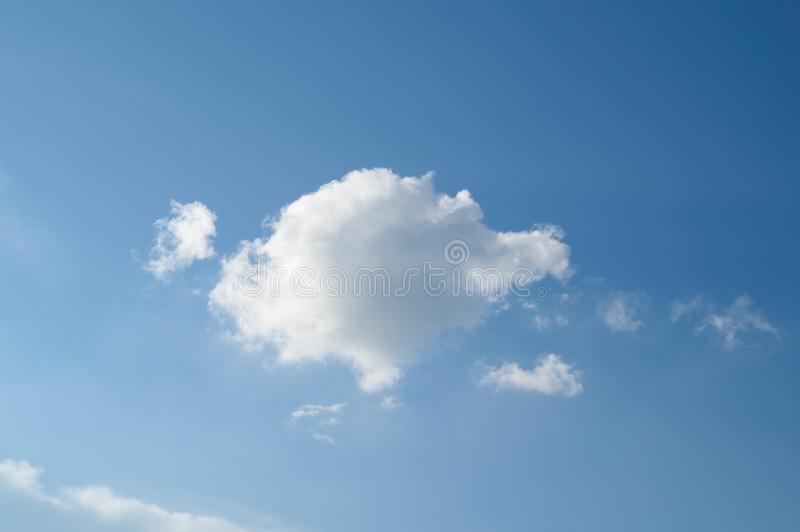 Blue sky with one white cloud background. Landscape sky. stock images